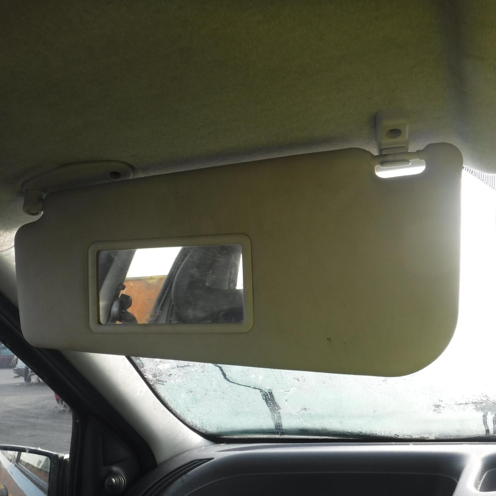 Service manual 2003 audi s6 remove the passenger side sun for Mirror visor